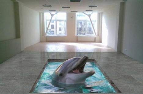 Un lindo delfín y en el fondo un piso bello