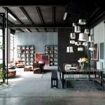 Loft en la ciudad de Milán que aplica colores oscuros en la madera y el metal y que lleva el diseño de este lugar al siguiente nivel