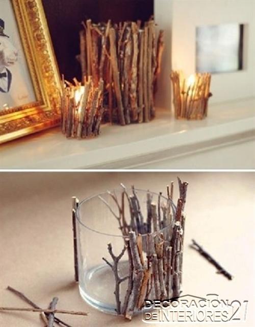 Portavelas decorativo rústico con ramas y vaso de vidrio